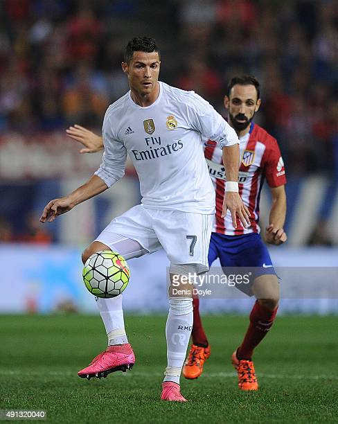 Cristiano Ronaldo of Real Madrid in action beside Juanfran of tletico de Madrid during the La Liga match between Club Atletico de Madrid and Real...