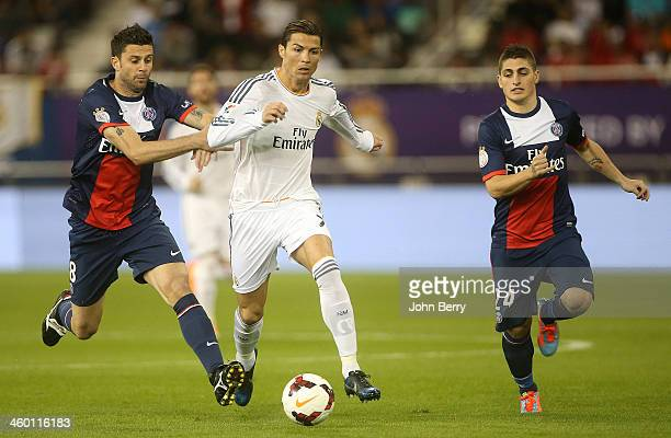 Cristiano Ronaldo of Real Madrid in action between Thiago Motta and Marco Verratti of PSG during the friendly match between Paris SaintGermain FC and...