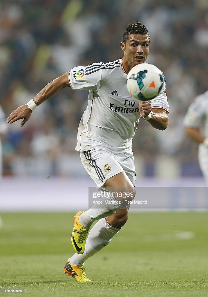 <a gi-track='captionPersonalityLinkClicked' href=/galleries/search?phrase=Cristiano+Ronaldo+-+Soccer+Player&family=editorial&specificpeople=162689 ng-click='$event.stopPropagation()'>Cristiano Ronaldo</a> of Real Madrid in action during the La Liga match between Real Madrid CF and Real Betis at Estadio Santiago Bernabeu on August 18, 2013 in Madrid, Spain.