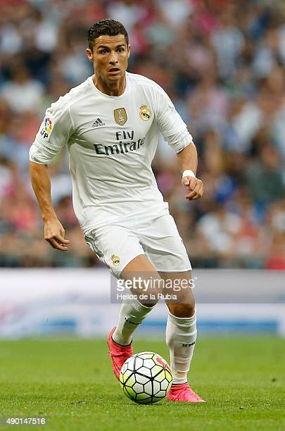Cristiano Ronaldo of Real Madrid in action during the La Liga match between Real Madrid CF and Malaga CF at Estadio Santiago Bernabeu on September 26...