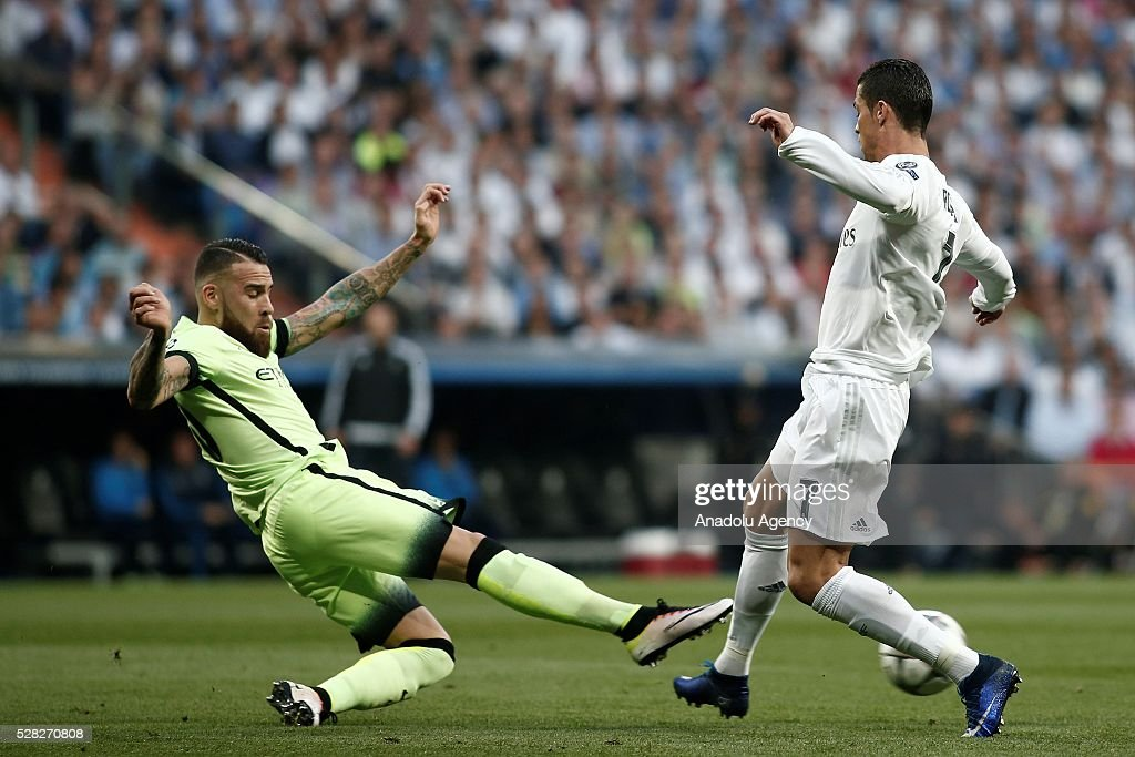 Cristiano Ronaldo (R) of Real Madrid in action during the UEFA Champions League semi-final second leg football match between Real Madrid and Manchester City at the Santiago Bernabeu Stadium in Madrid, Spain on May 4, 2016.