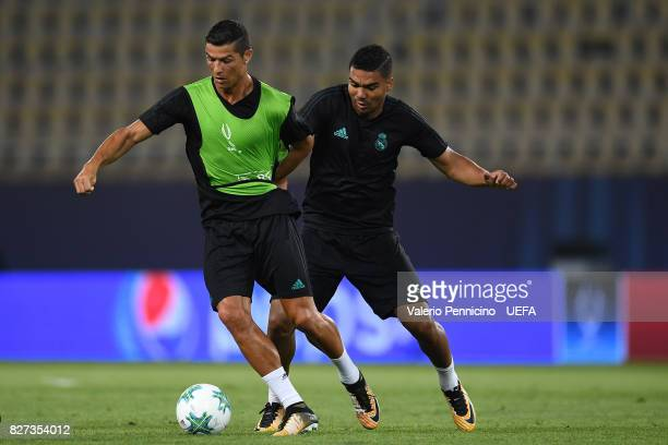 Cristiano Ronaldo of Real Madrid is challenged by Casemiro during the training session ahead of the UEFA Super Cup between Real Madrid and Manchester...