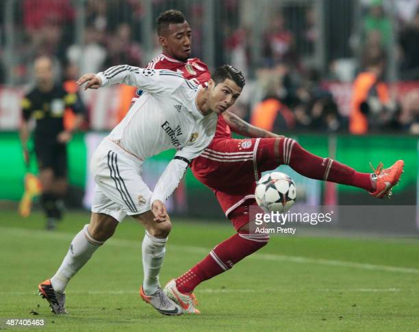 Cristiano Ronaldo of Real Madrid is challenged by Jerome Boateng of Bayern Muenchen during the UEFA Champions League semifinal second leg match...