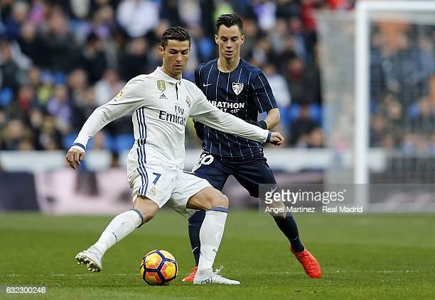 Cristiano Ronaldo of Real Madrid is challenged by Juan Pablo Anor of Malaga CF during the La Liga match between Real Madrid and Malaga CF at Estadio...
