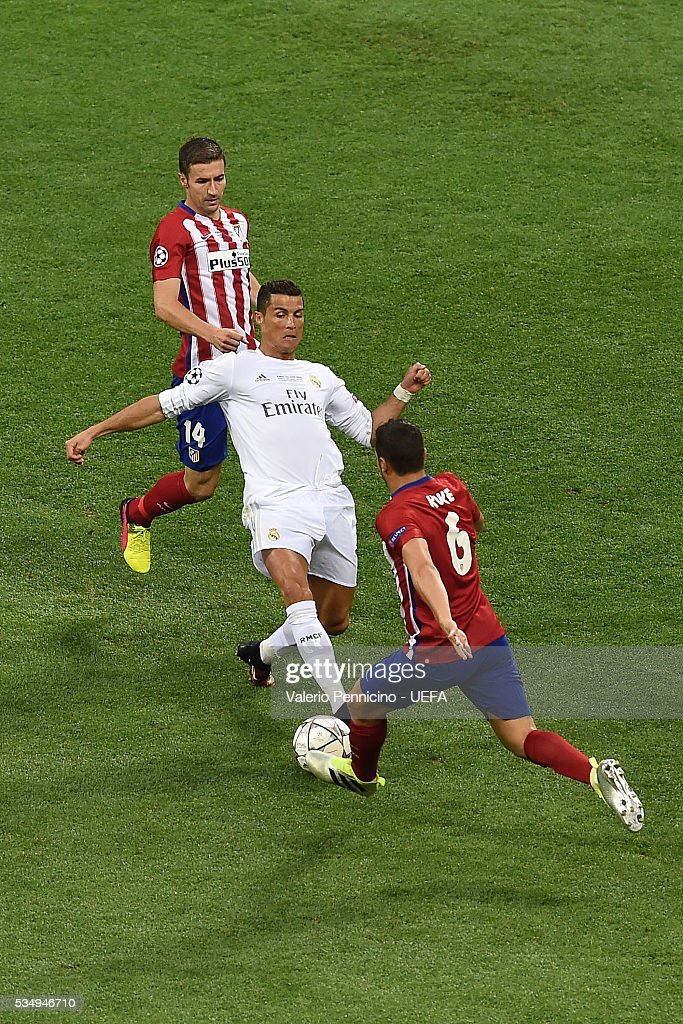 <a gi-track='captionPersonalityLinkClicked' href=/galleries/search?phrase=Cristiano+Ronaldo+-+Soccer+Player&family=editorial&specificpeople=162689 ng-click='$event.stopPropagation()'>Cristiano Ronaldo</a> (C) of Real Madrid is challenged by <a gi-track='captionPersonalityLinkClicked' href=/galleries/search?phrase=Koke+-+Midfielder+born+1992&family=editorial&specificpeople=11132098 ng-click='$event.stopPropagation()'>Koke</a> (R) of Club Atletico de Madrid during the UEFA Champions League Final between Real Madrid and Club Atletico de Madrid at Stadio Giuseppe Meazza on May 28, 2016 in Milan, Italy.