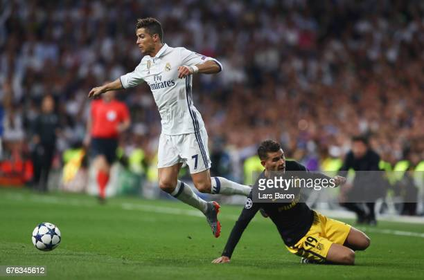 Cristiano Ronaldo of Real Madrid is challenged by Lucas Hernandez of Atletico Madrid during the UEFA Champions League semi final first leg match...