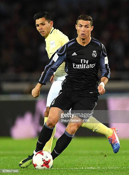 Cristiano Ronaldo of Real Madrid is chased down by Silvio Romero of Club America during the FIFA Club World Cup Semi Final match between Club America...