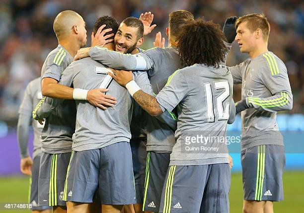 Cristiano Ronaldo of Real Madrid is congratulated by team mates after scoring a goal during the International Champions Cup match between Real Madrid...