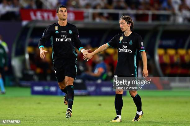 Cristiano Ronaldo of Real Madrid is greeted by teammate Luka Modric as he comes on as a substitute during the UEFA Super Cup match between Real...