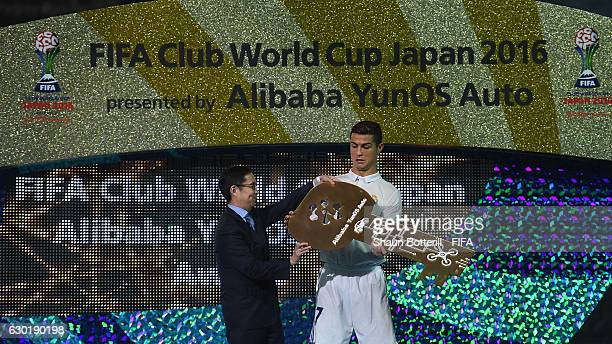 Cristiano Ronaldo of Real Madrid is handed the man of the match award after the FIFA Club World Cup final match between Real Madrid and Kashima...