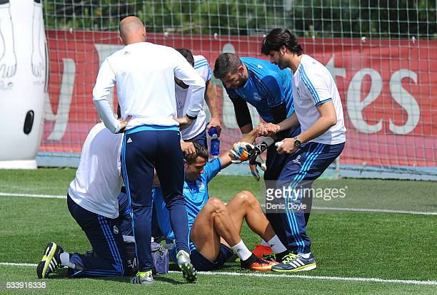 Cristiano Ronaldo of Real Madrid is helped after getting injured in the team training session during the Real Madrid Open Media Day ahead of the UEFA...