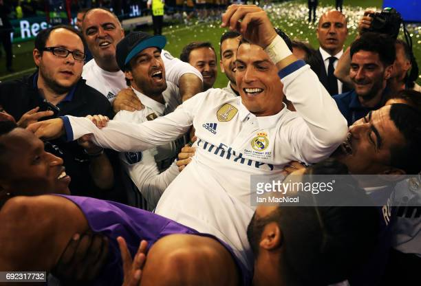 Cristiano Ronaldo of Real Madrid is lifted by his team mates during the UEFA Champions League Final between Juventus and Real Madrid at National...