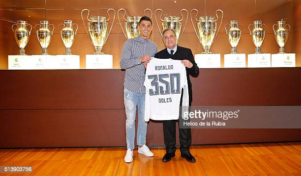 Cristiano Ronaldo of Real Madrid is presented with a shirt to commemorate his 350th goal by Real Madrid President Florentino Perez after the La Liga...