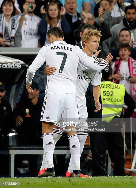 Cristiano Ronaldo of Real Madrid is replaced by Martin Odegaard during the La Liga match between Real Madrid CF and Getafe CF at Estadio Santiago...