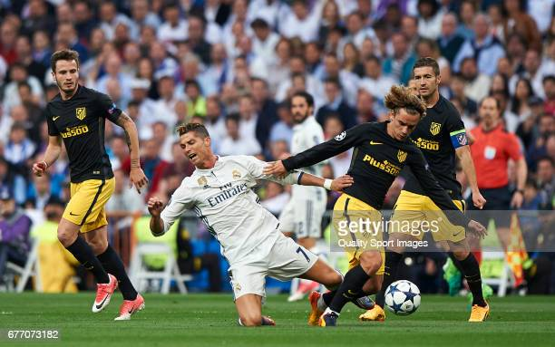 Cristiano Ronaldo of Real Madrid is tackled by Antoine Griezmann of Club Atletico de Madrid during the UEFA Champions League semifinal first leg...