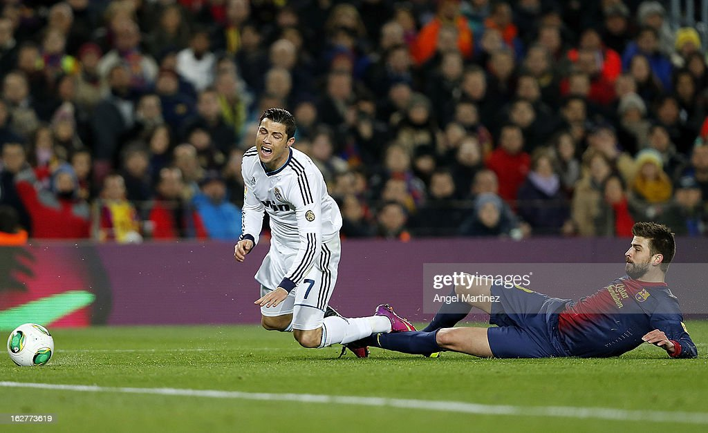 <a gi-track='captionPersonalityLinkClicked' href=/galleries/search?phrase=Cristiano+Ronaldo+-+Soccer+Player&family=editorial&specificpeople=162689 ng-click='$event.stopPropagation()'>Cristiano Ronaldo</a> of Real Madrid is tackled by <a gi-track='captionPersonalityLinkClicked' href=/galleries/search?phrase=Gerard+Pique&family=editorial&specificpeople=227191 ng-click='$event.stopPropagation()'>Gerard Pique</a> of Barcelona during the Copa del Rey semi final second leg match between FC Barcelona and Real Madrid CF at Camp Nou on February 26, 2013 in Barcelona, Spain.