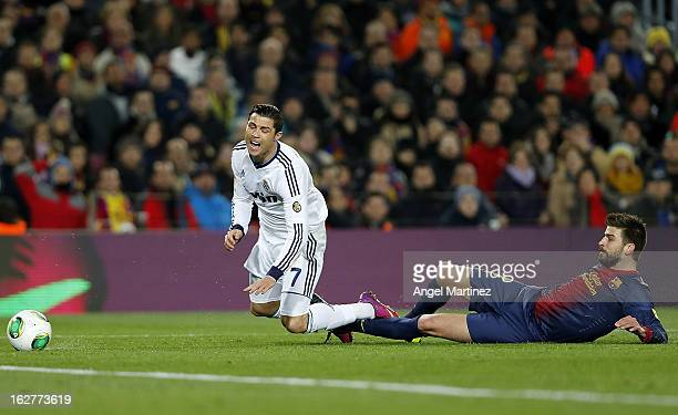 Cristiano Ronaldo of Real Madrid is tackled by Gerard Pique of Barcelona during the Copa del Rey semi final second leg match between FC Barcelona and...