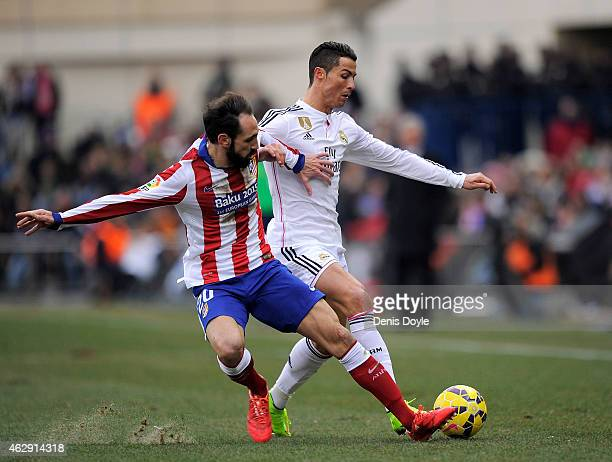 Cristiano Ronaldo of Real Madrid is tackled by Juanfran of Club Atletico de Madrid during the La Liga match between Club Atletico de Madrid and Real...