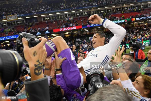 Cristiano Ronaldo of Real Madrid is thrown into the air by his Real Madrid team mates after the UEFA Champions League Final between Juventus and Real...