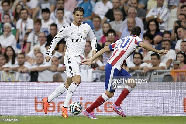 Cristiano Ronaldo of Real Madrid Juan Francisco Torres Belen Juanfran of Atletico de Madrid during the Spanisch Super Cup match between Real Madrid...