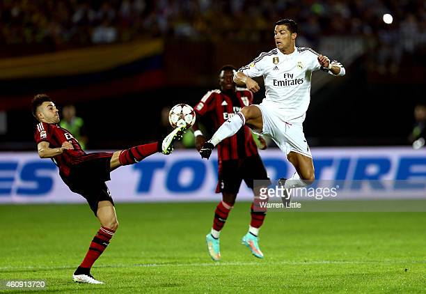 Cristiano Ronaldo of Real Madrid jumps above Jeremy Mendez of AC Milan to win the ball during the Dubai Football Challenge match between AC Milan and...