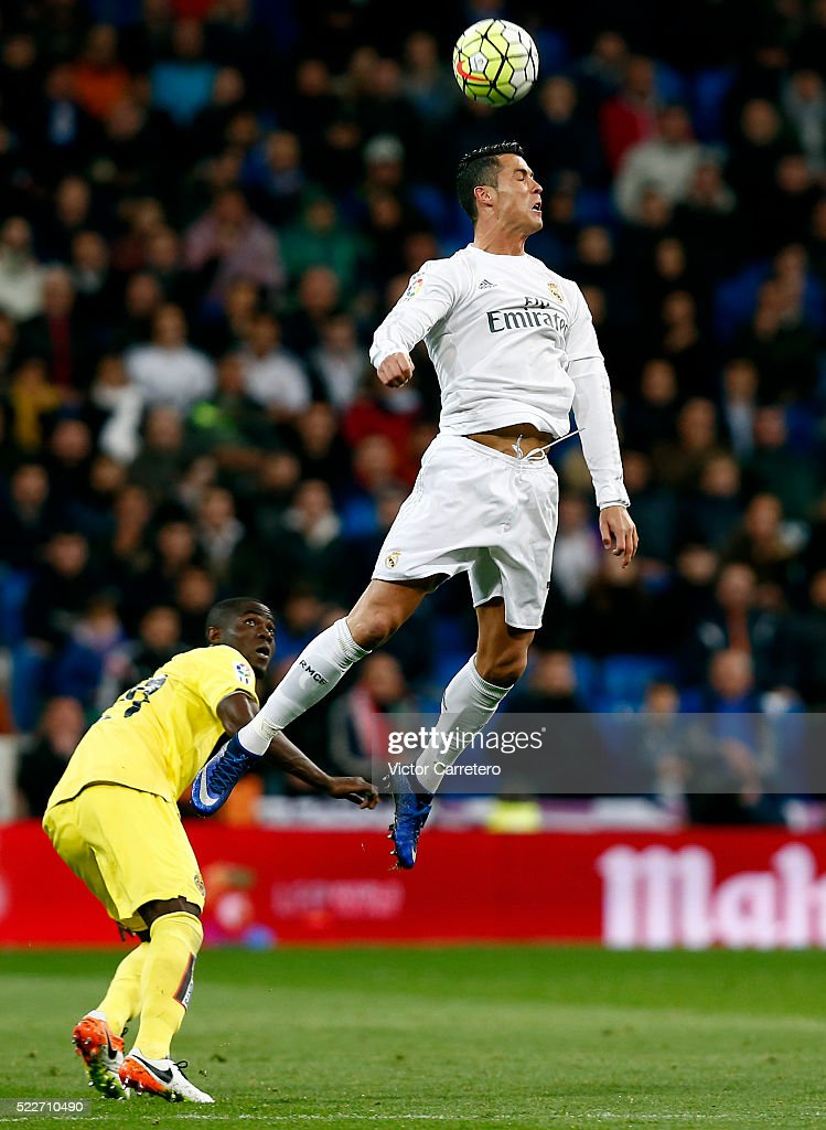 Cristiano Ronaldo of Real Madrid jumps for the ball during the La Liga match between Real Madrid CF and Villarreal CF at Estadio Santiago Bernabeu on April 20, 2016 in Madrid, Spain.