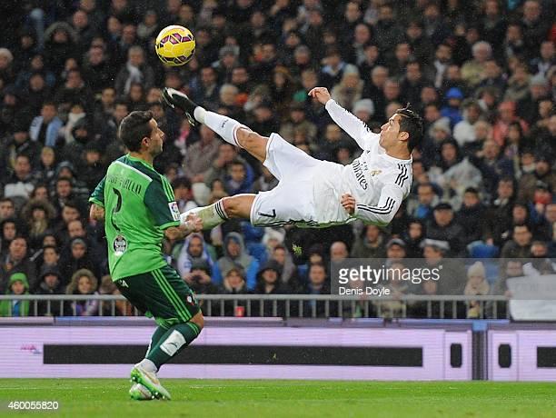 Cristiano Ronaldo of Real Madrid kicks the ball past Hugo Mallo of Celta de Vigo during the La Liga match between Real Madrid CF and Celta Vigo at...