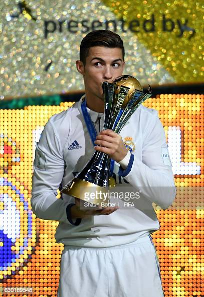 Cristiano Ronaldo of Real Madrid kisses the trophy during the FIFA Club World Cup Final match between Real Madrid and Kashima Antlers at...