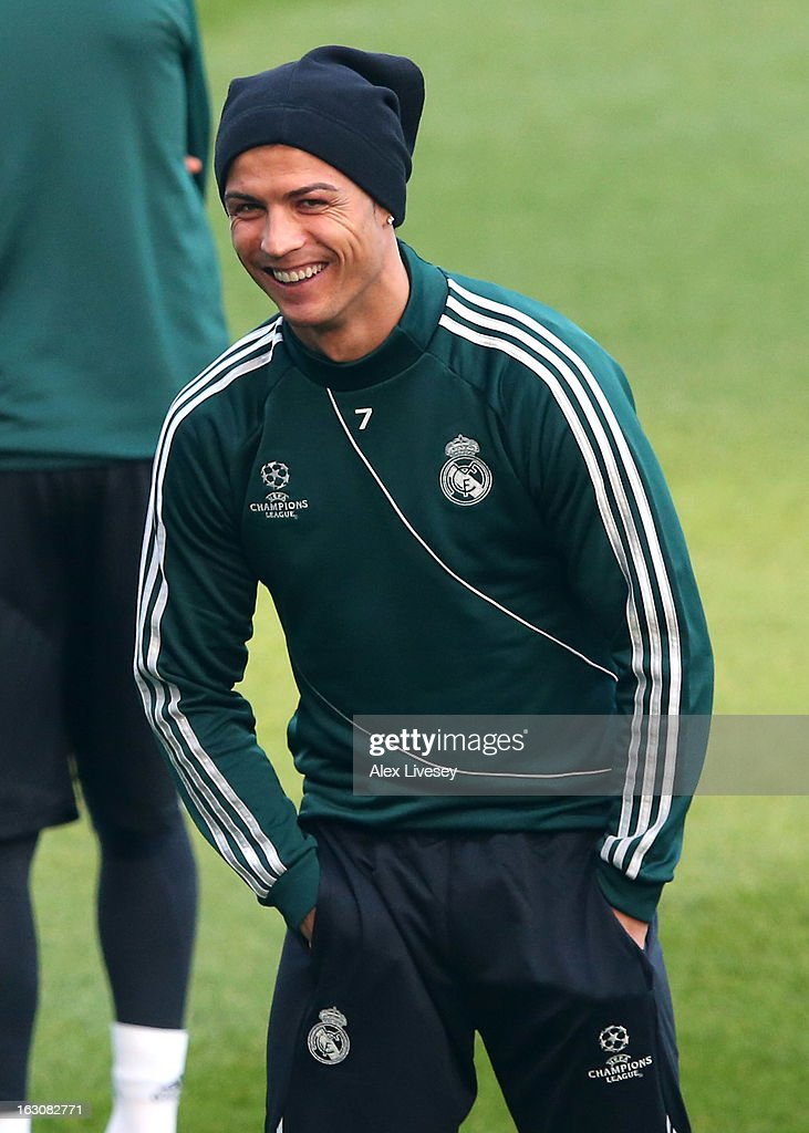<a gi-track='captionPersonalityLinkClicked' href=/galleries/search?phrase=Cristiano+Ronaldo+-+Soccer+Player&family=editorial&specificpeople=162689 ng-click='$event.stopPropagation()'>Cristiano Ronaldo</a> of Real Madrid laughs during a training session at Etihad Stadium on March 4, 2013 in Manchester, England.