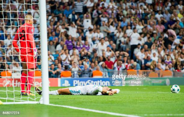 Cristiano Ronaldo of Real Madrid lies on the pitch in front of the APOEL FC's gate as goalkeeper Boy Waterman of APOEL FC looks on during the UEFA...