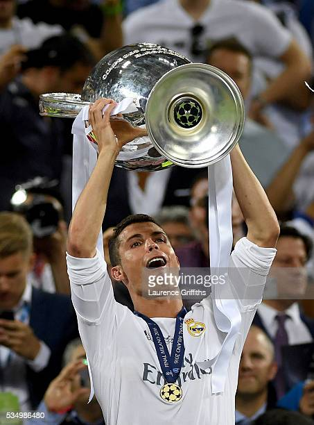 Cristiano Ronaldo of Real Madrid lifts the Champions League trophy after the UEFA Champions League Final match between Real Madrid and Club Atletico...