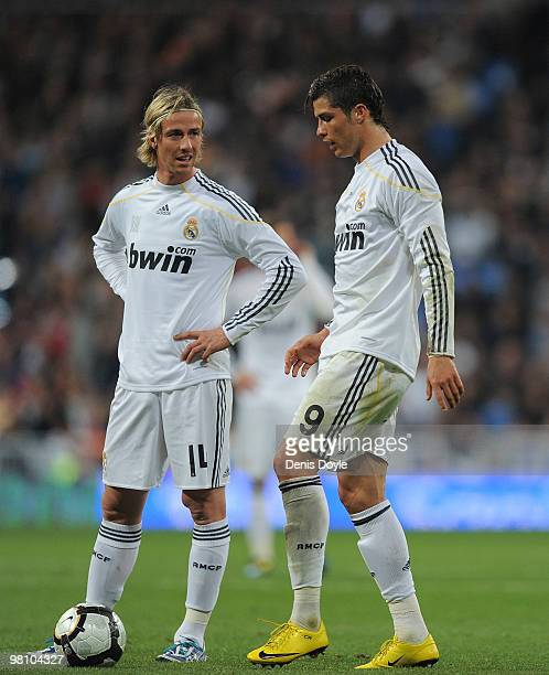 Cristiano Ronaldo of Real Madrid linesup a free kick beside Guti during the La Liga match between Real Madrid and Atletico Madrid at Estadio Santiago...