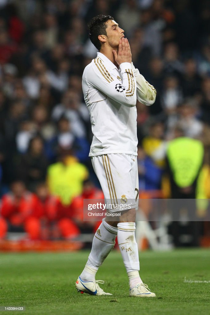 <a gi-track='captionPersonalityLinkClicked' href=/galleries/search?phrase=Cristiano+Ronaldo+-+Soccer+Player&family=editorial&specificpeople=162689 ng-click='$event.stopPropagation()'>Cristiano Ronaldo</a> of Real Madrid looks dejected after missing a penalty during the penalty shoot-out during the UEFA Champions League semi final second leg match between Real Madrid and Bayern Muenchen at Bernabeu Stadium on April 25, 2012 in Madrid, Spain.