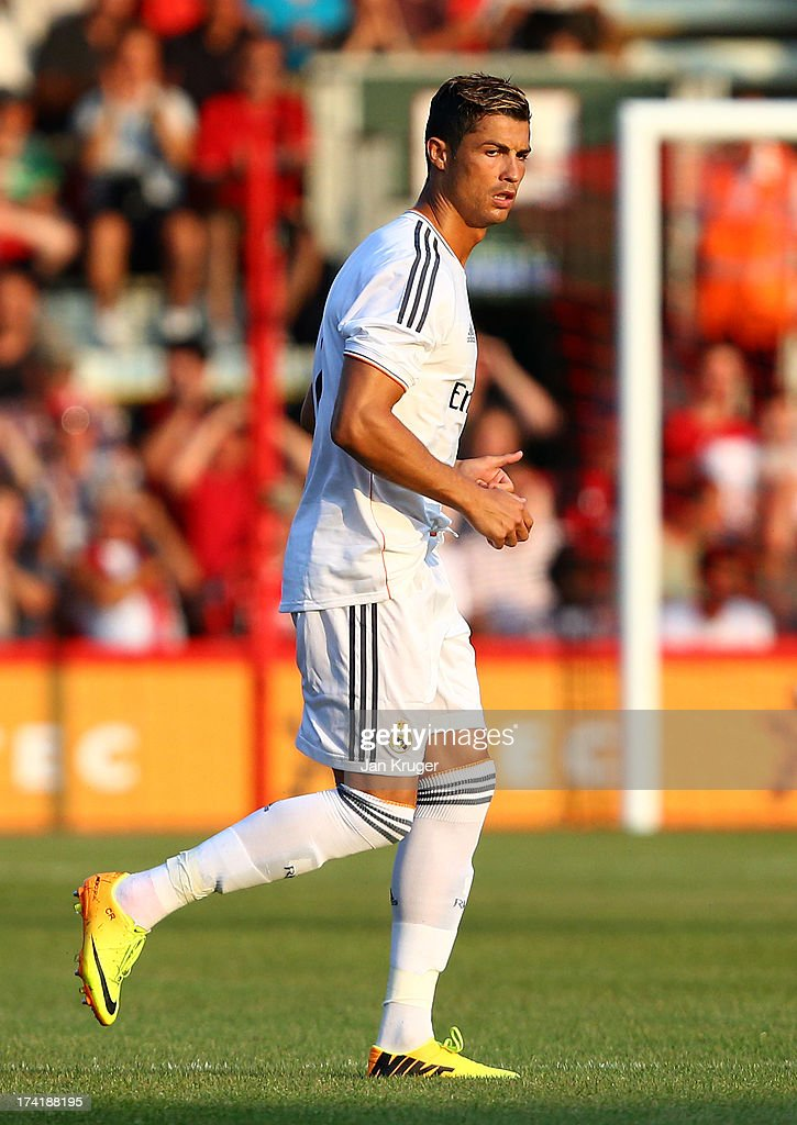 <a gi-track='captionPersonalityLinkClicked' href=/galleries/search?phrase=Cristiano+Ronaldo&family=editorial&specificpeople=162689 ng-click='$event.stopPropagation()'>Cristiano Ronaldo</a> of Real Madrid looks on during a pre season friendly match between AFC Bournemouth and Real Madrid at Goldsands Stadium on July 21, 2013 in Bournemouth, England.