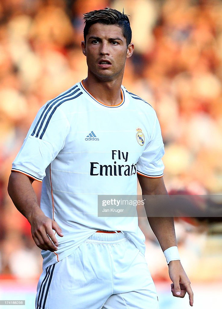 <a gi-track='captionPersonalityLinkClicked' href=/galleries/search?phrase=Cristiano+Ronaldo+-+Soccer+Player&family=editorial&specificpeople=162689 ng-click='$event.stopPropagation()'>Cristiano Ronaldo</a> of Real Madrid looks on during a pre season friendly match between AFC Bournemouth and Real Madrid at Goldsands Stadium on July 21, 2013 in Bournemouth, England.