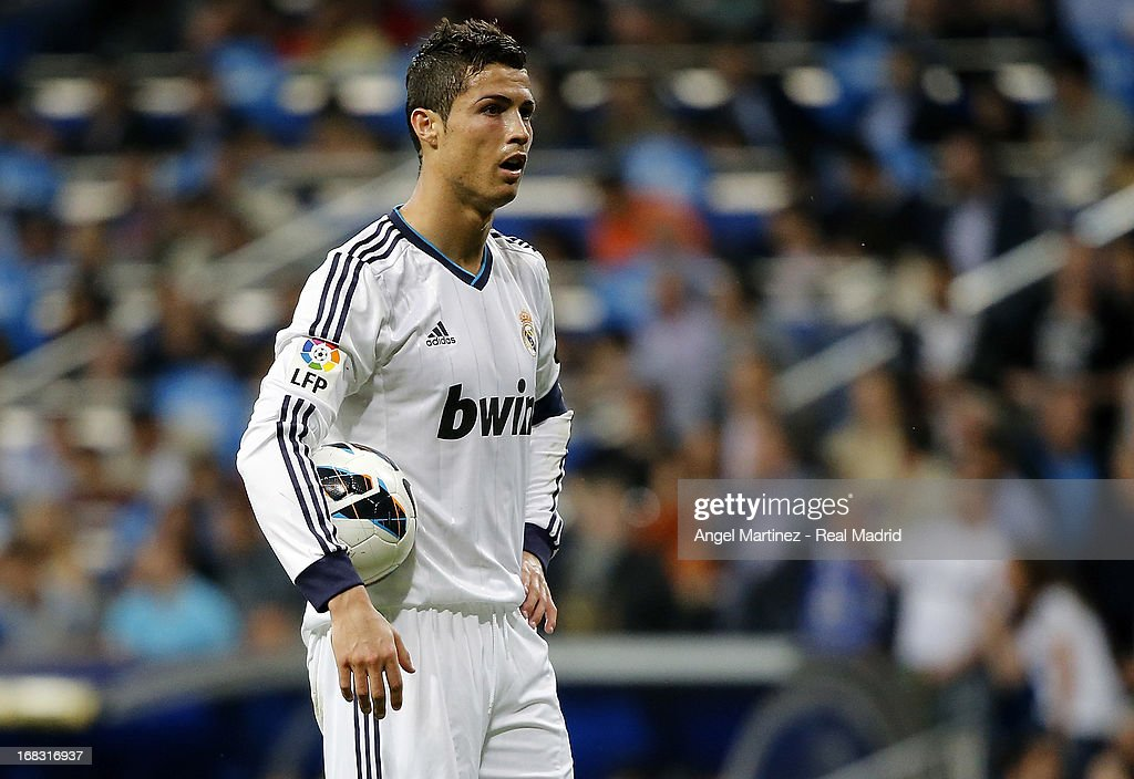 <a gi-track='captionPersonalityLinkClicked' href=/galleries/search?phrase=Cristiano+Ronaldo+-+Soccer+Player&family=editorial&specificpeople=162689 ng-click='$event.stopPropagation()'>Cristiano Ronaldo</a> of Real Madrid looks on during the La Liga match between Real Madrid and Malaga at Estadio Santiago Bernabeu on May 8, 2013 in Madrid, Spain.