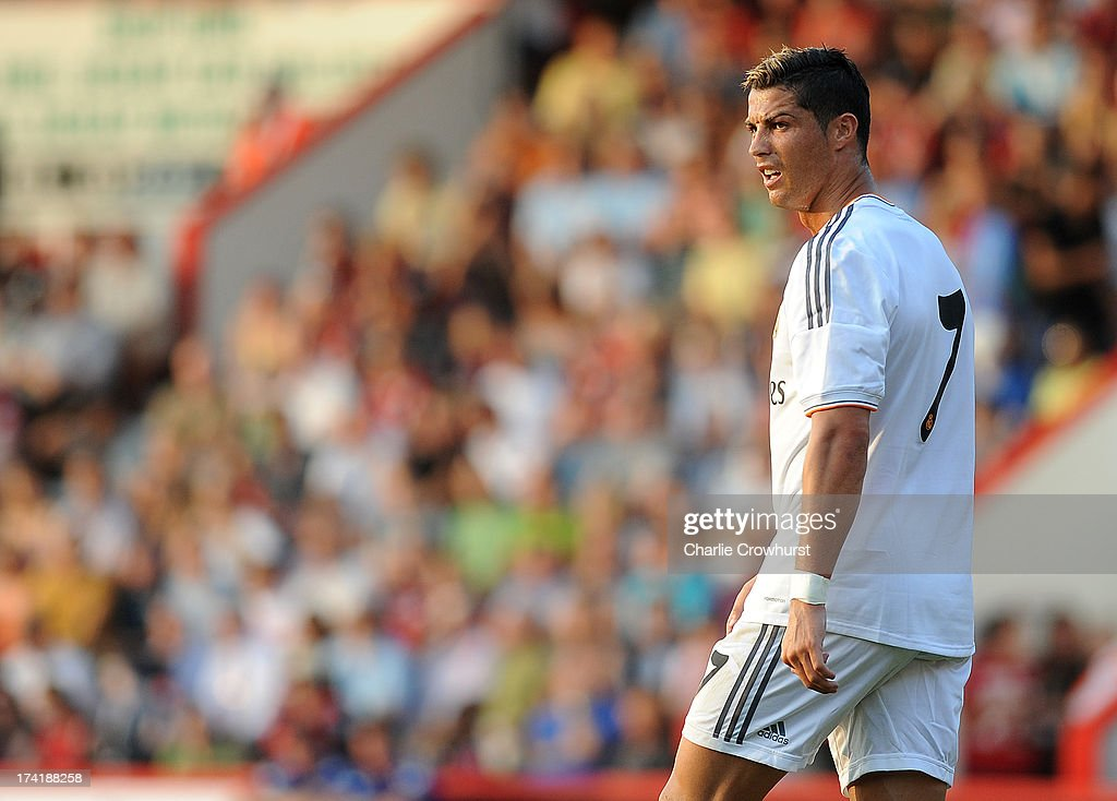 <a gi-track='captionPersonalityLinkClicked' href=/galleries/search?phrase=Cristiano+Ronaldo&family=editorial&specificpeople=162689 ng-click='$event.stopPropagation()'>Cristiano Ronaldo</a> of Real Madrid looks on during the pre season friendly match between Bournemouth and Real Madrid at Goldsands Stadium on July 21, 2013 in Bournemouth, England,