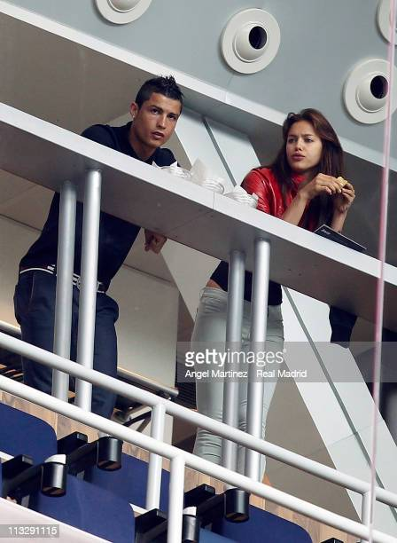 Cristiano Ronaldo of Real Madrid looks on next to his girlfriend Irina Shayk before the La Liga match between Real Madrid and Real Zaragoza at...