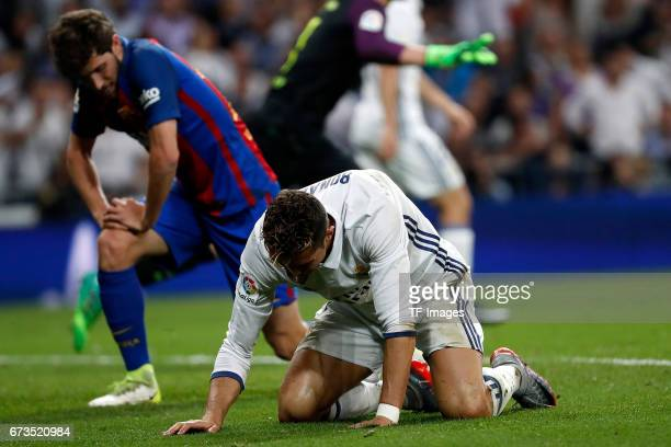 Cristiano Ronaldo of Real Madrid on the ground during the La Liga match between Real Madrid CF and FC Barcelona at the Santiago Bernabeu stadium on...