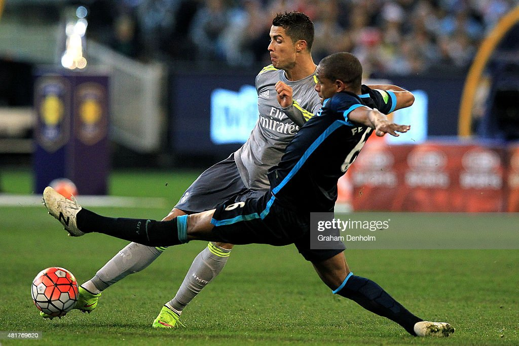 Cristiano Ronaldo of Real Madrid (L) passes whilst being challenged by Fernando Reges of Manchester City during the International Champions Cup match between Real Madrid and Manchester City at Melbourne Cricket Ground on July 24, 2015 in Melbourne, Australia.