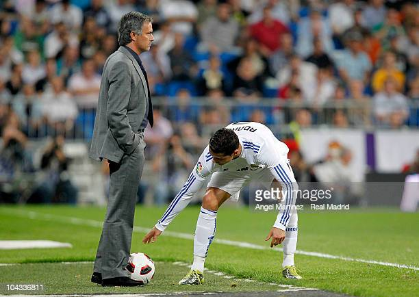 Cristiano Ronaldo of Real Madrid picks up the ball beside his head coach Jose Mourinho during the La Liga match between Real Madrid and Espanyol at...