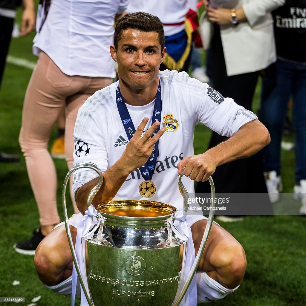 <a gi-track='captionPersonalityLinkClicked' href=/galleries/search?phrase=Cristiano+Ronaldo+-+Soccer+Player&family=editorial&specificpeople=162689 ng-click='$event.stopPropagation()'>Cristiano Ronaldo</a> of Real Madrid poses for a photo with the Champions League trophy during the UEFA Champions League Final between Real Madrid and Atletico Madrid at Stadio Giuseppe Meazza on May 28, 2016 in Milan, Italy.