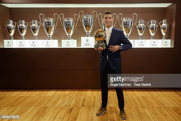 Cristiano Ronaldo of Real Madrid poses with the Ballon D'Or 2016 trophy at Estadio Santiago Bernabeu on December 12 2016 in Madrid Spain