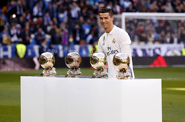 BALLON D'OR ET RECOMPENSES DU FOOT - Page 9 Cristiano-ronaldo-of-real-madrid-poses-with-the-ballon-dor-france-picture-id631134078?k=6&m=631134078&s=612x612&w=0&h=jcdZsrHAKfYwOvMjR07GpEI6xkGUSJ0Qz_P-Lw6S06c=
