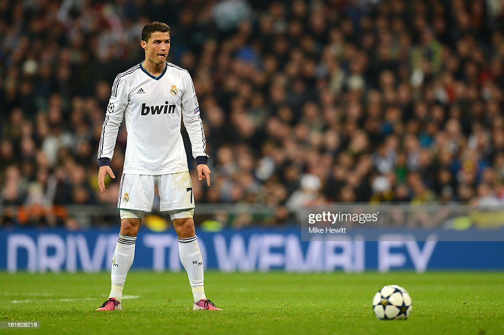 Cristiano Ronaldo of Real Madrid prepares to take a free kick during the UEFA Champions League Round of 16 first leg match between Real Madrid and Manchester United at Estadio Santiago Bernabeu on February 13, 2013 in Madrid, Spain.