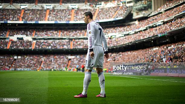 Cristiano Ronaldo of Real Madrid prepares to take a free kick during the la Liga match between Real Madrid CF and FC Barcelona at Estadio Santiago...