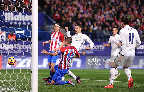 Cristiano Ronaldo of Real Madrid puts the ball in the nets only for the goal to be disallowed during the La Liga match between Club Atletico de...