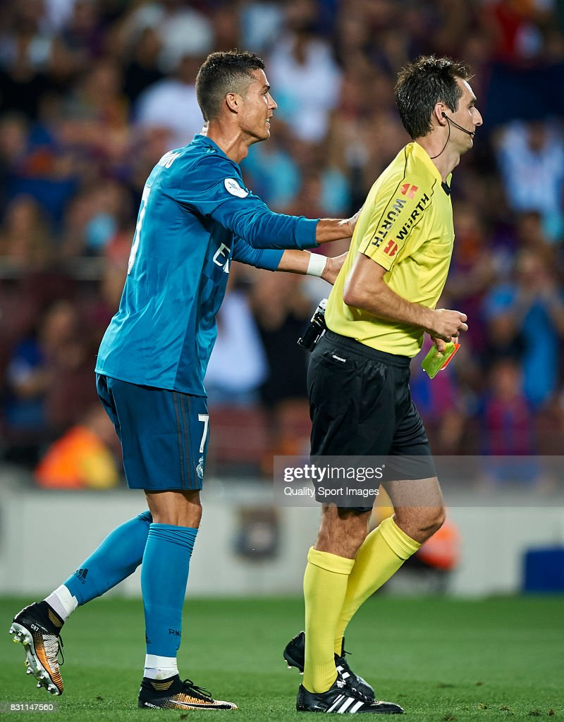 Cristiano Ronaldo (L) of Real Madrid reacts after a red card during the Supercopa de Espana Supercopa Final 1st Leg match between FC Barcelona and Real Madrid at Camp Nou on August 13, 2017 in Barcelona, Spain.