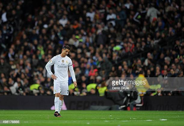 Cristiano Ronaldo of Real Madrid reacts after FC Barcelona scored their 2nd goal during the La Liga match between Real Madrid and Barcelona at...