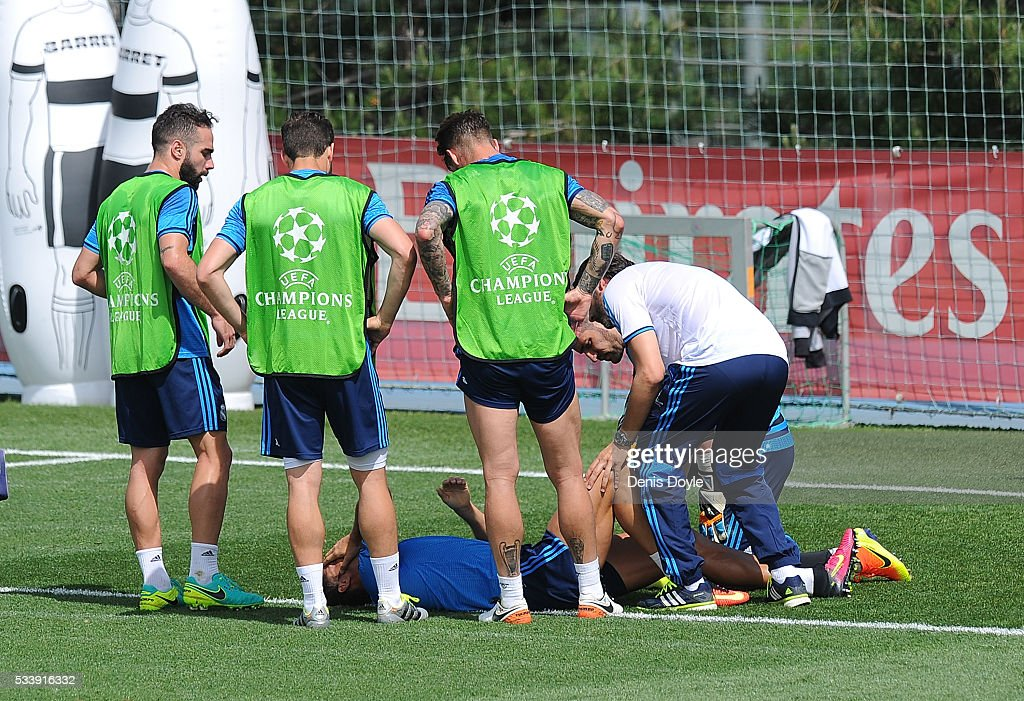 <a gi-track='captionPersonalityLinkClicked' href=/galleries/search?phrase=Cristiano+Ronaldo+-+Calciatore&family=editorial&specificpeople=162689 ng-click='$event.stopPropagation()'>Cristiano Ronaldo</a> of Real Madrid reacts after getting injured in the team training session during the Real Madrid Open Media Day ahead of the UEFA Champions League Final against Club Atletico Madrid at Valdebebas training ground on May 24, 2016 in Madrid, Spain.
